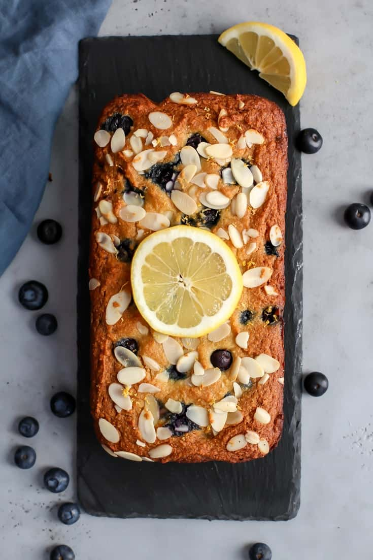 Loaf of Paleo Lemon Blueberry Bread with lemon slice garnish