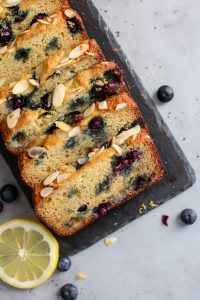 Sliced Paleo Lemon Blueberry Bread on slate tray