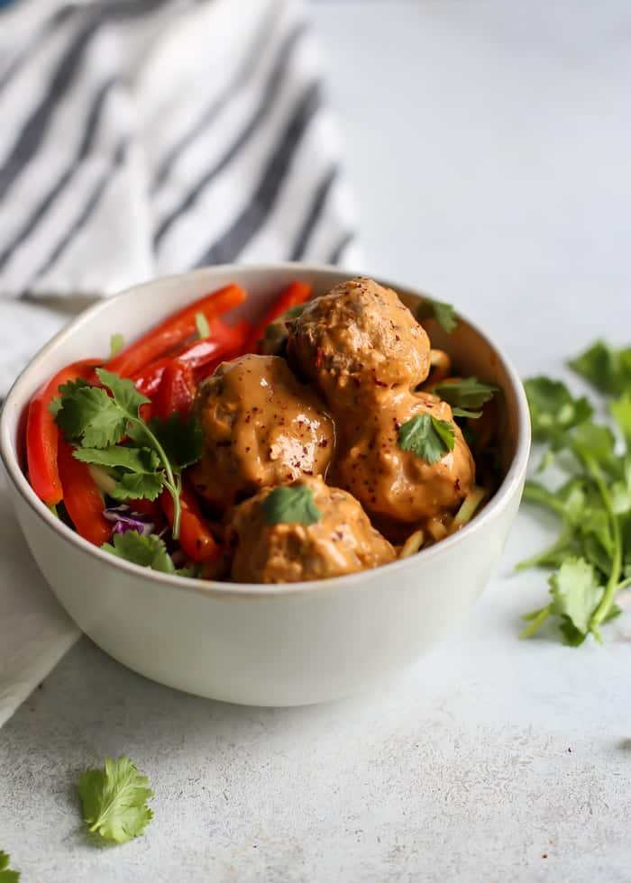Turkey meatballs in bowl with red bell pepper and cilantro