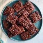 Healthier brownies cut up on teal plate