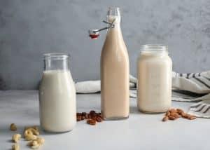 glass jars and bottles of homemade nut milk