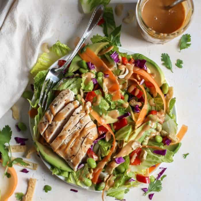 grilled chicken thai salad with peanut dressing in jar