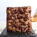 stacked banana bread with chocolate chips placed on slate tray