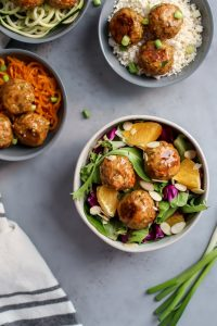 salmon meatballs in salad bowl, sweet potato noodle bowl, and cauliflower rice bowl