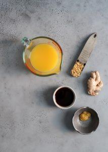 orange juice, minced garlic, ginger paste, coconut aminos and apple cider vinegar