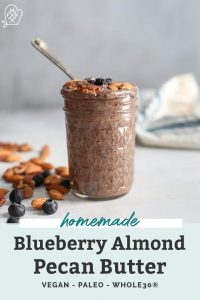 mason jar of nut butter with blueberries and almonds