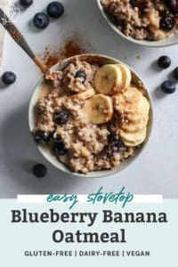 warm blueberry banana oatmeal in bowl topped with cinnamon