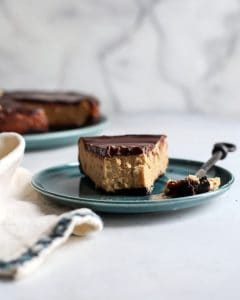 slice of peanut butter cheesecake on dessert plate with fork