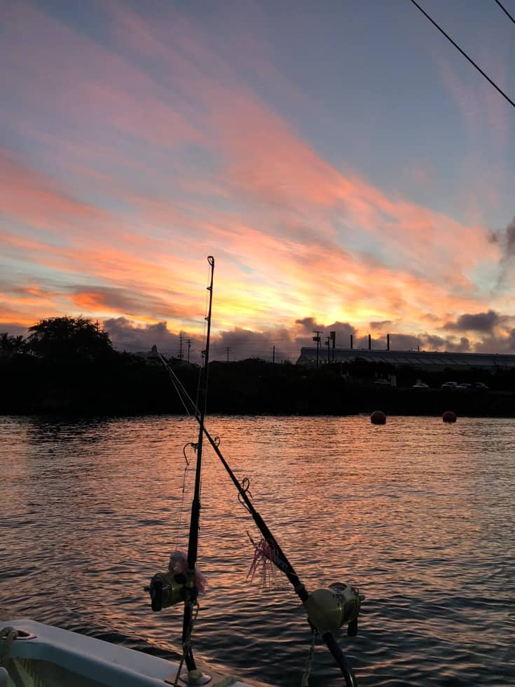 sunrise on fishing boat in kauai