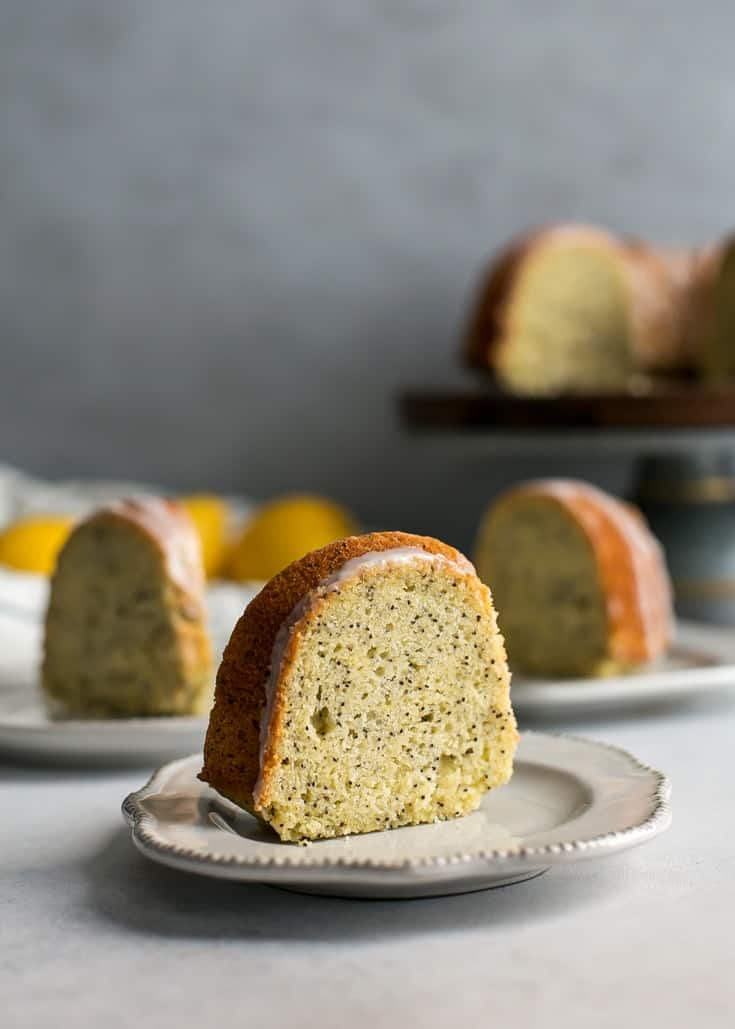 Sliced lemon poppy seed bundt cake on dessert plates