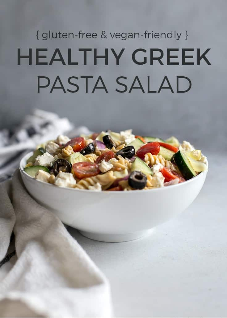gluten free and vegan friendly healthy greek pasta salad in white bowl