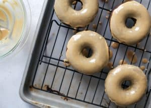 espresso glazed grain-free chocolate donuts on cooling rack