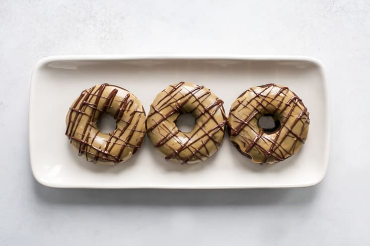tray of grain-free chocolate donuts with espresso glaze and chocolate drizzle