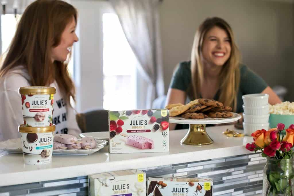 laughing around kitchen bar with ice cream treats for a girls night in