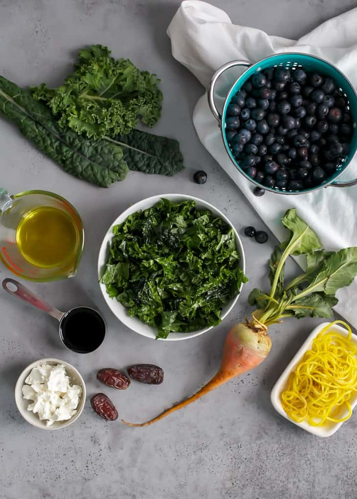 ingredients for blueberry kale salad with spiralized golden beets, goat cheese, olive oil