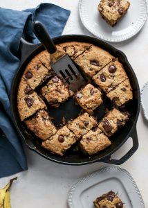 chocolate chip banana skillet cake with plates and serving spatula