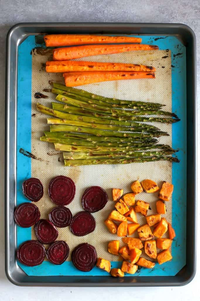 roasted carrots, asparagus, beets an sweet potatoes on baking sheet