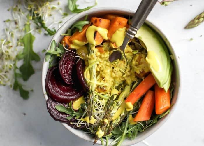 Roasted Veggie Spring Power Bowl with turmeric tahini dressing