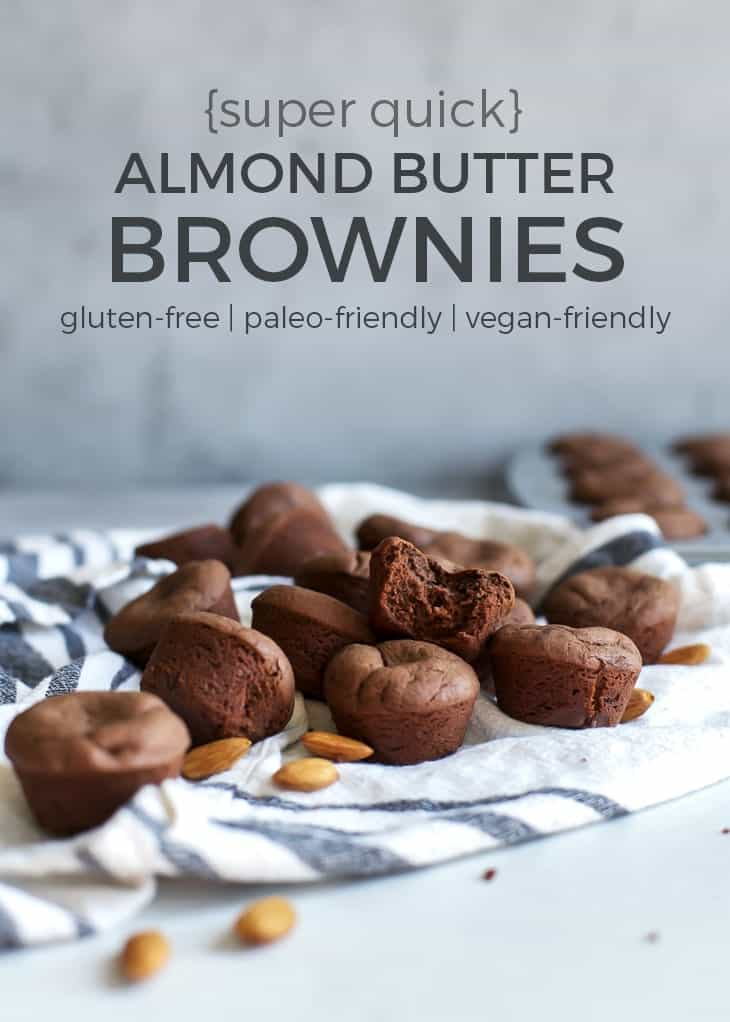 mini almond butter brownie bites on towel with almonds