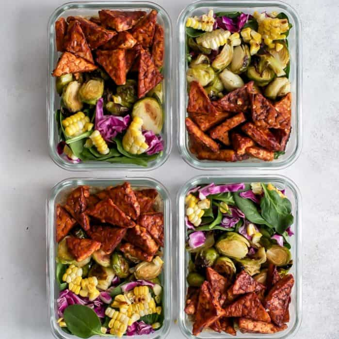 4 meal prep containers of vegan bbq tempeh bowls