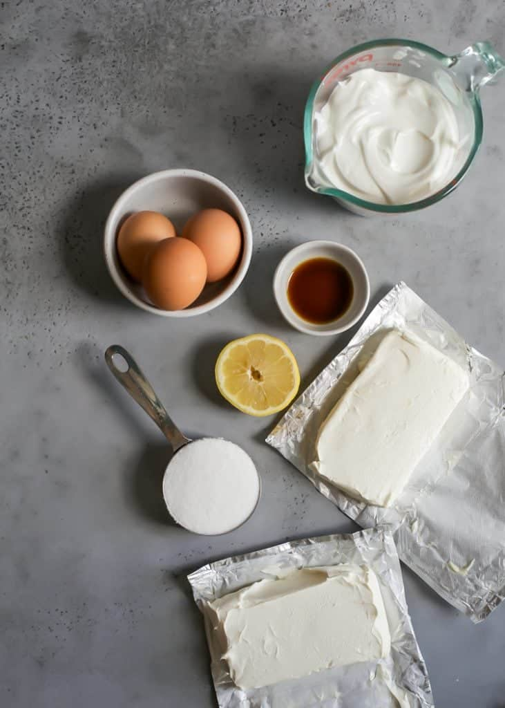 eggs, vanilla, lemon, greek yogurt, cream cheese and sugar for greek yogurt cheesecake