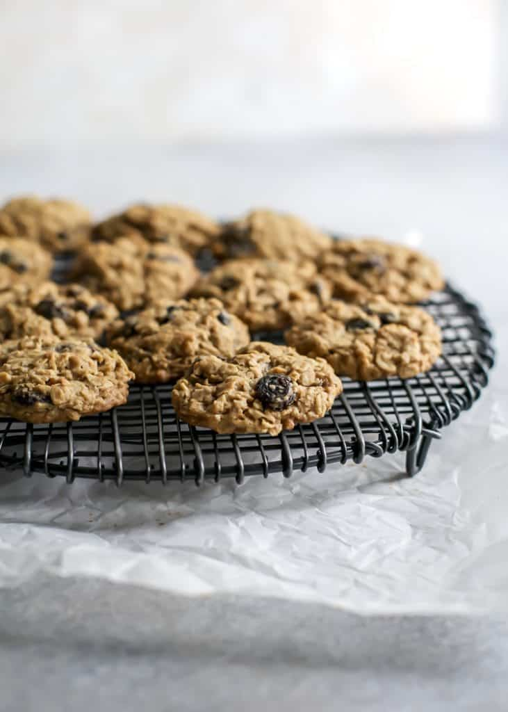 baked healthier oatmeal raisin cookies on round wire rack