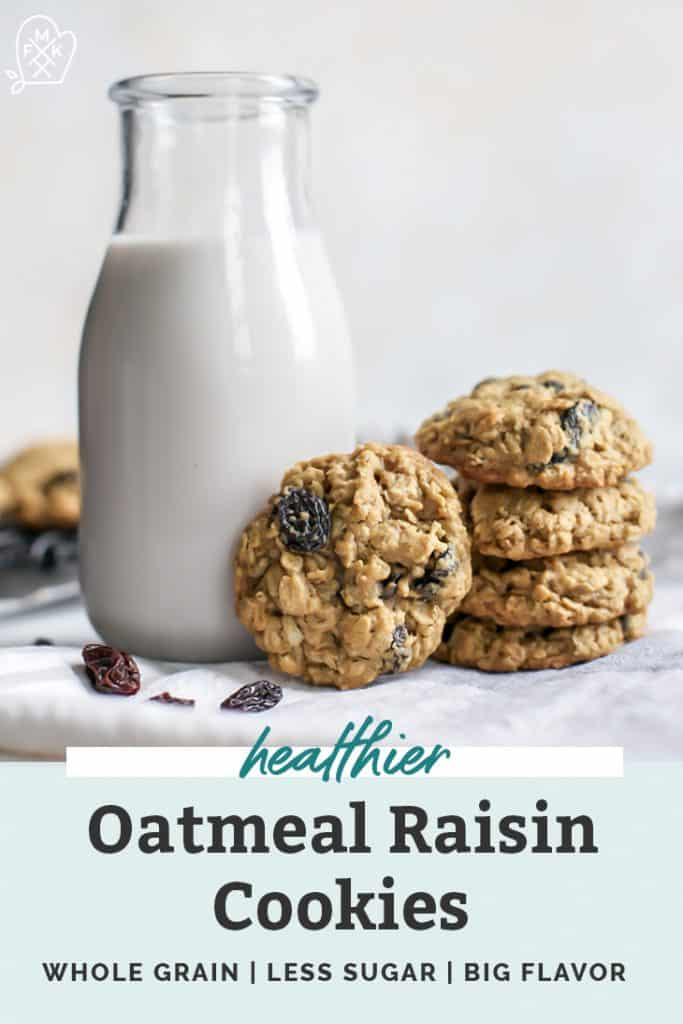 stacked oatmeal raisin cookies next to glass bottle of milk
