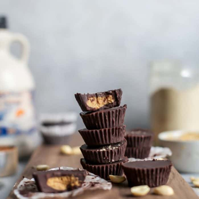 Homemade Maple Maca Peanut Butter Cups with a homemade chocolate base! These are so easy, just a few simple steps and you have yourself homemade chocolate peanut butter cups! (Of course feel free to sub your favorite nut butter for dietary reasons) | fitmittenkitchen.com #veganrecipes #vegandessert #nobakedesserts #peanutbutter #peanutbuttercups #cleaneating #healthyrecipes