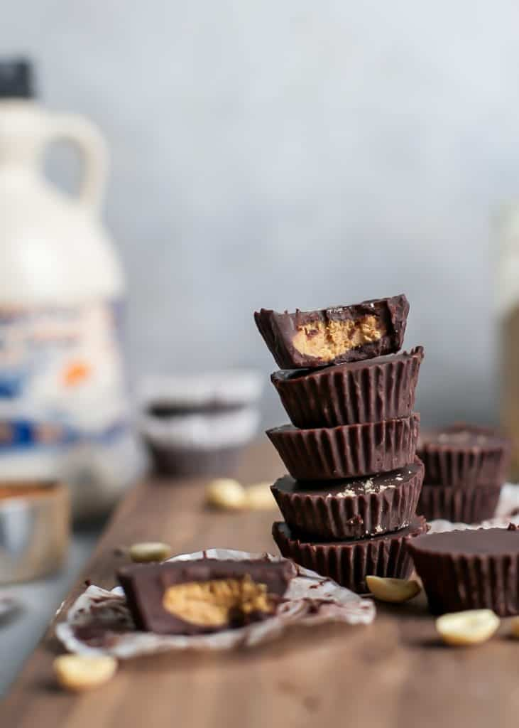 stacked homemade peanut butter cups with maple syrup