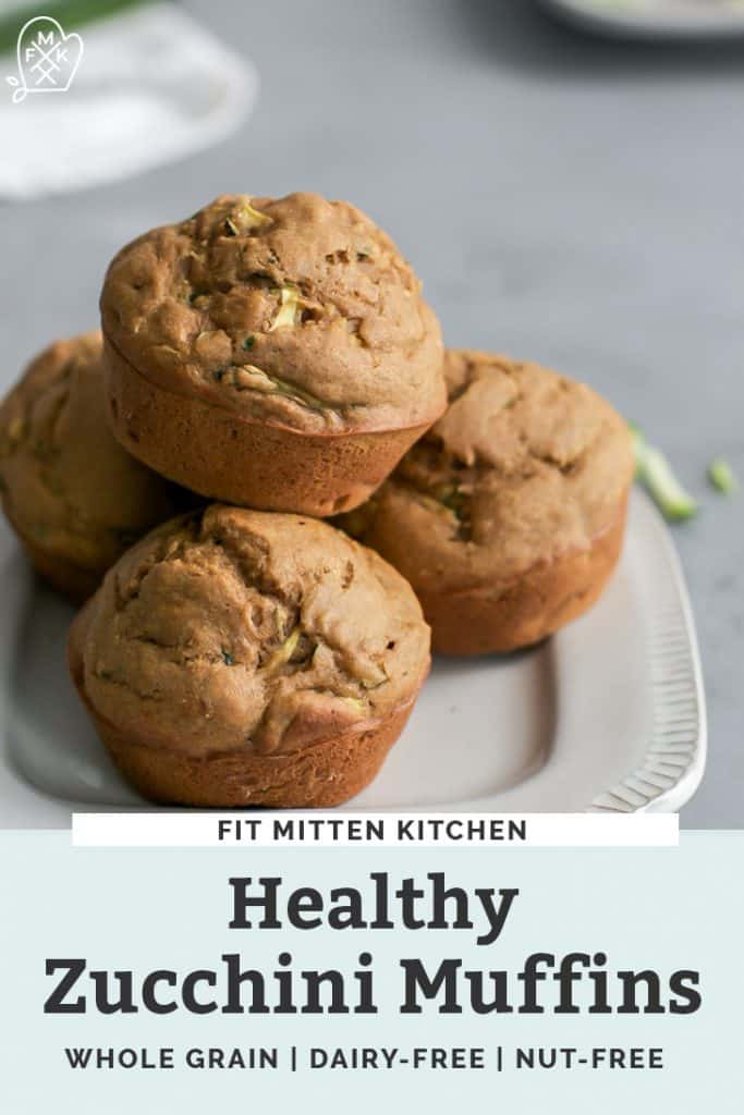 healthy zucchini muffins stacked on white plate
