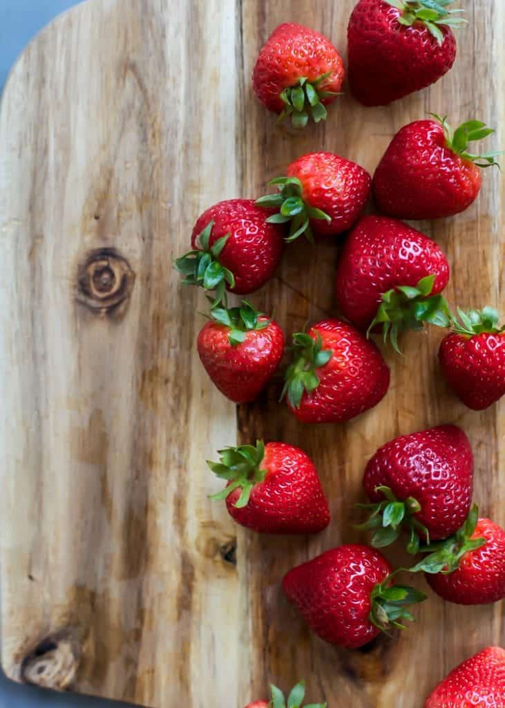 fresh strawberries on cutting board