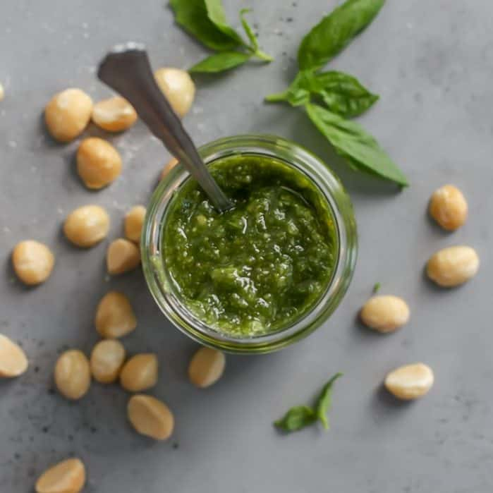 jar of basil pesto with macadamia nuts
