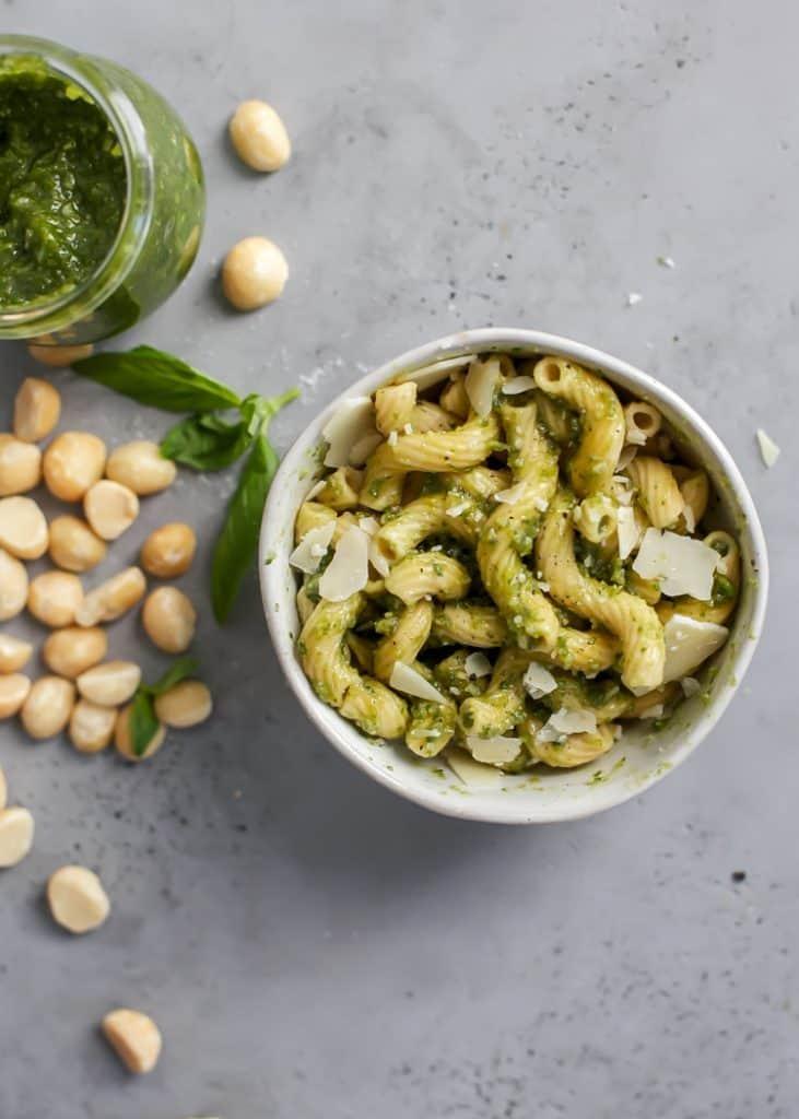 bowl of chickpea pasta with fresh macadamia nut basil pesto.