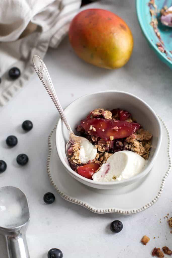 ice cream bowl with mango blueberry crisp