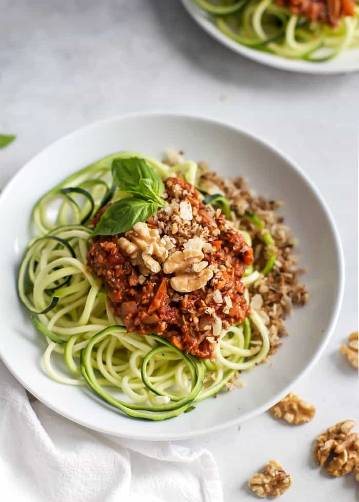 plate of zucchini noodles in bowl with meatless walnut bolognese