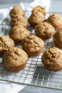freshly baked healthy zucchini muffins on cooling rack