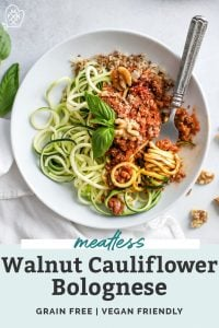 bowls of zucchini noodles in bowl with meatless walnut bolognese