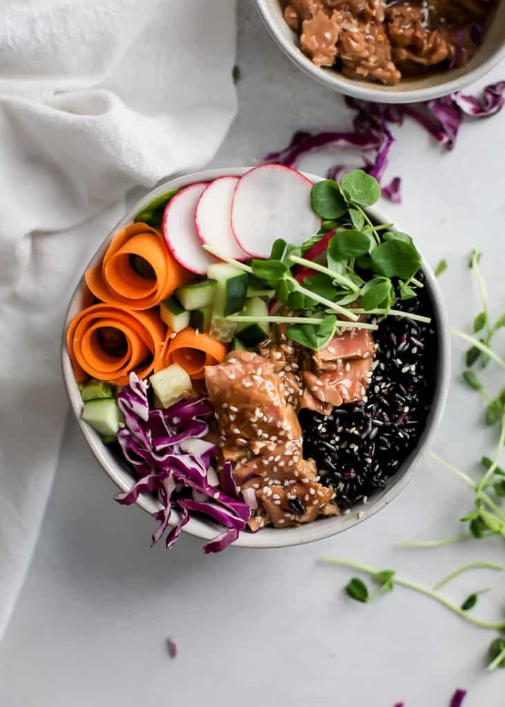 forbidden rice bowl with ahi tuna, carrot ribbons, purple cabbage, radishes and sprouts