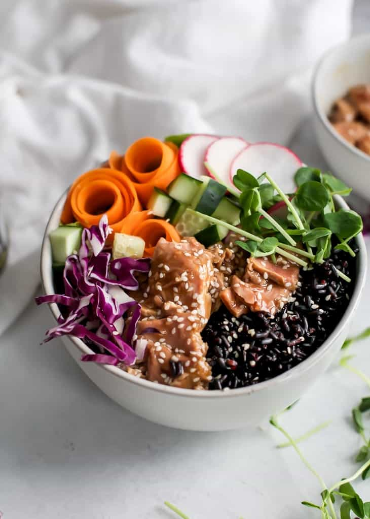 forbidden rice bowl with ahi tuna and sliced veggies