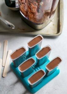 fudge pops in popsicle molds prepared for freezer