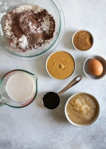 milk, peanut butter, maple syrup, flour, cocoa powder ingredients for chocolate peanut butter muffins