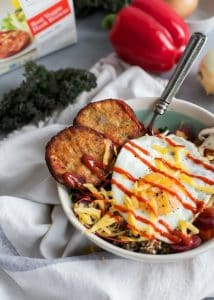 veggie breakfast bowl with fried egg and hash browns with sriracha