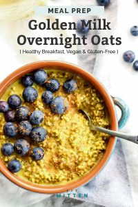Golden Milk Overnight Oats with blueberries in teal bowl
