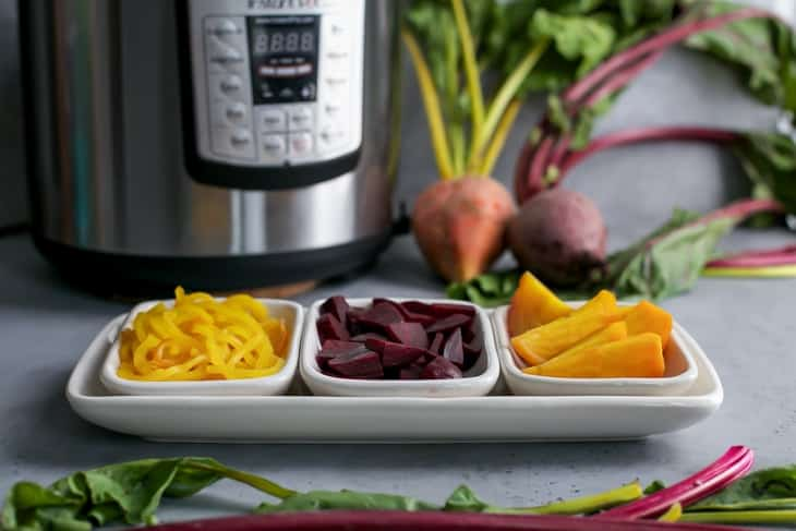 square serving bowls with golden and red beets with instant pot