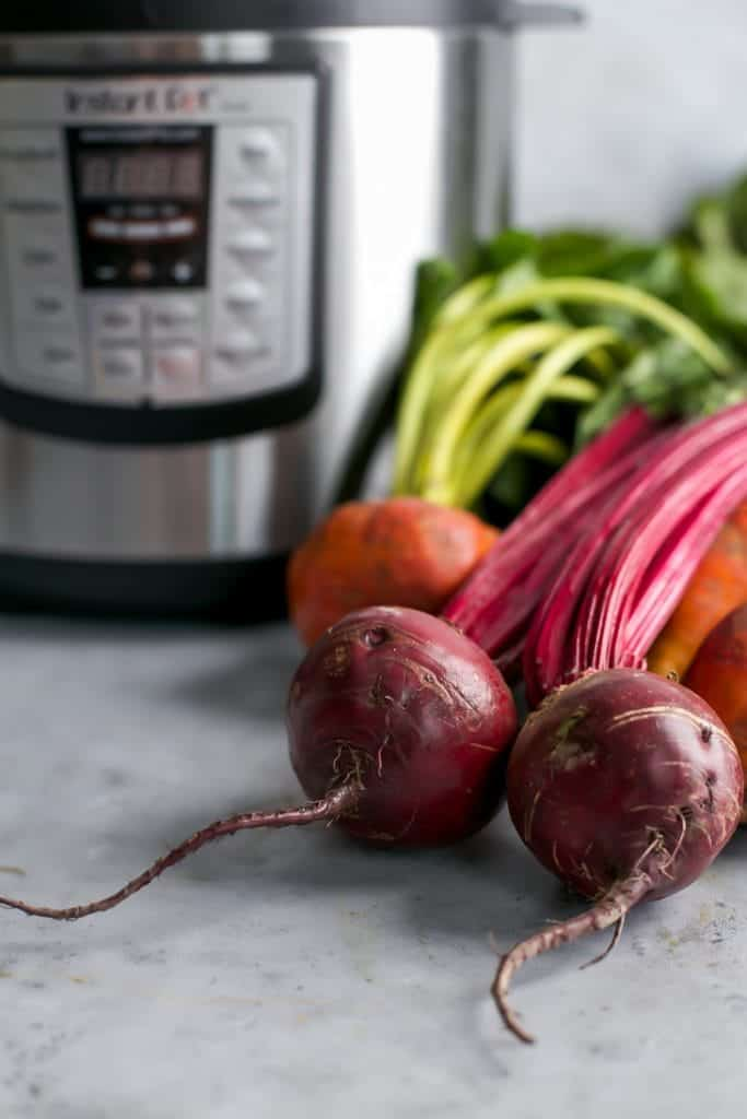raw beets next to Instant Pot