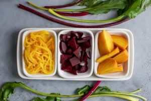 golden beet noodles, chopped red beets and quartered golden beets on tray.