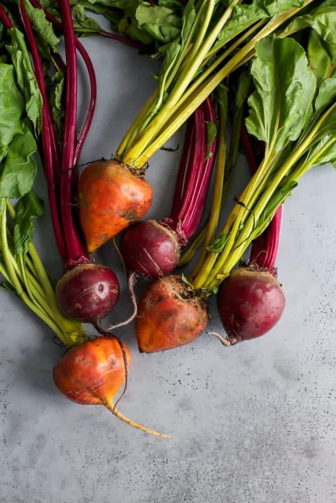 fresh organic red and golden beets with stems