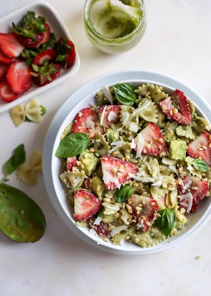 Strawberry Avocado Pesto Pasta Salad in white bowl