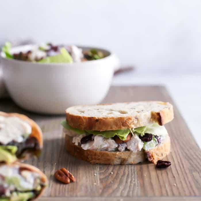 cherry chicken salad sandwich on board