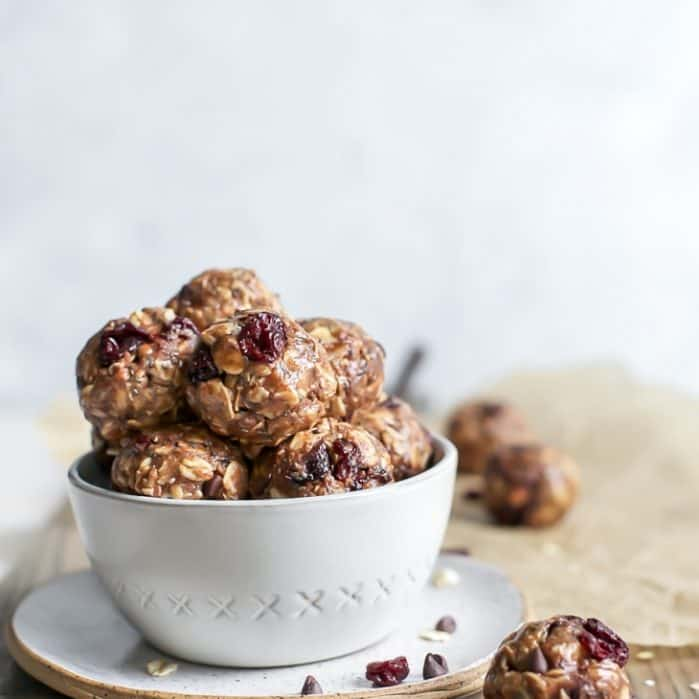 cherry chocolate chip energy balls in bowl on plate